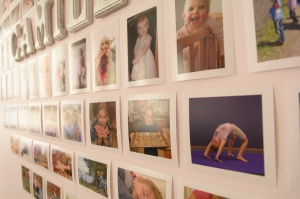 Family photographs hung on wall