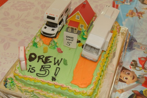 Miniature RVs on a cake