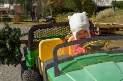 Baby driving John Deere ride
