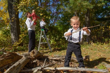Boy in front of family with sticks