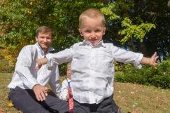 Boy blocking family during photo shoot