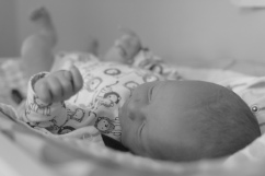 newborn laying on changing table