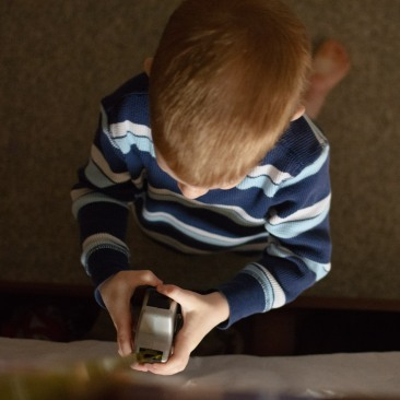 preschooler holding measuring tape