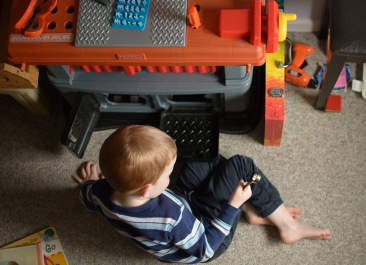 boy with tool bench