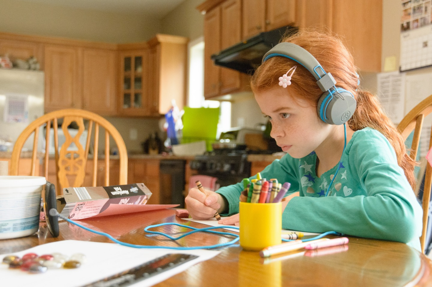 girl with headphone learning to draw