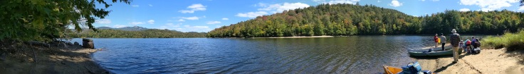 panorama of lake with canoers