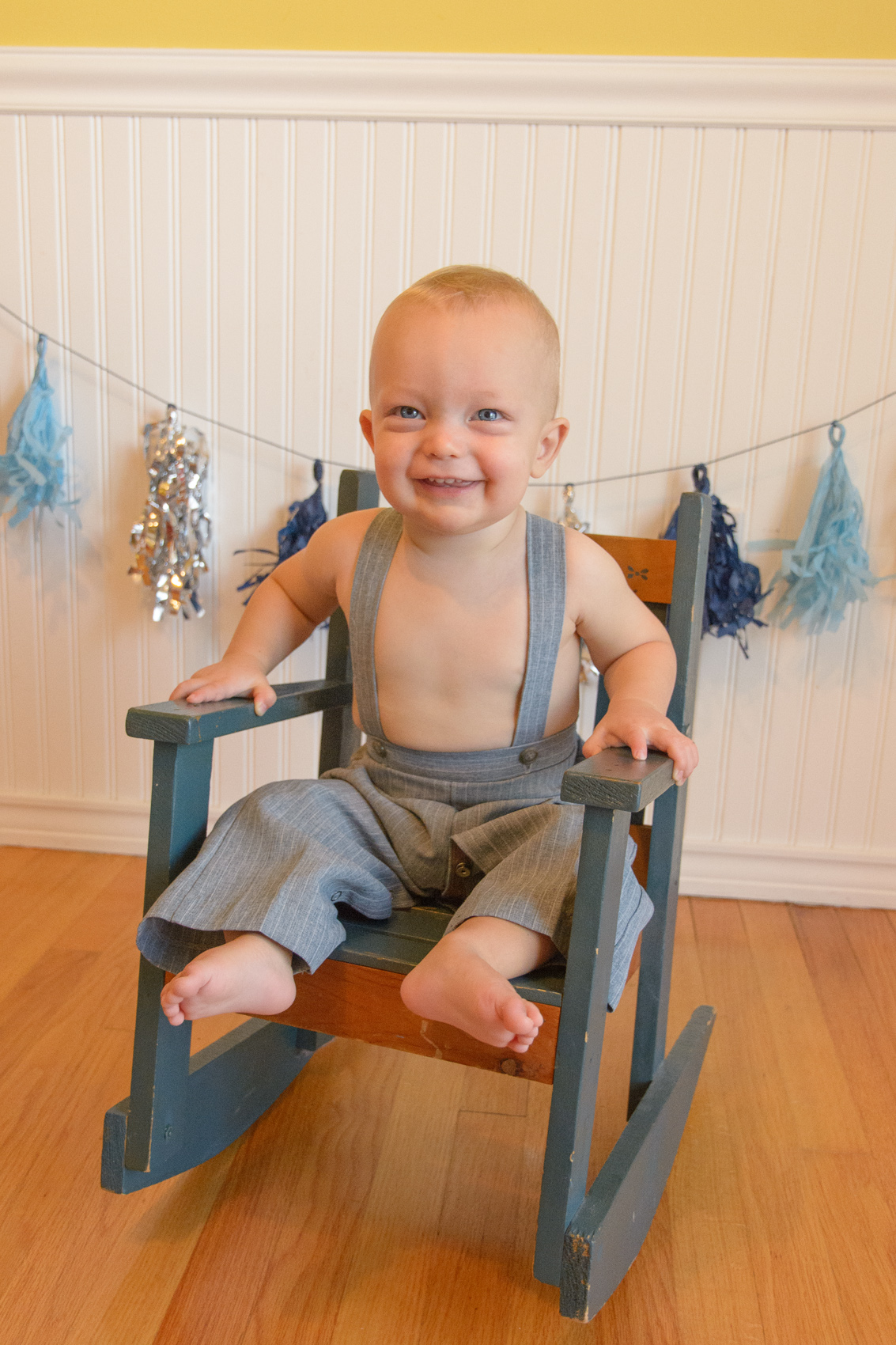infant smiling in rocking chair