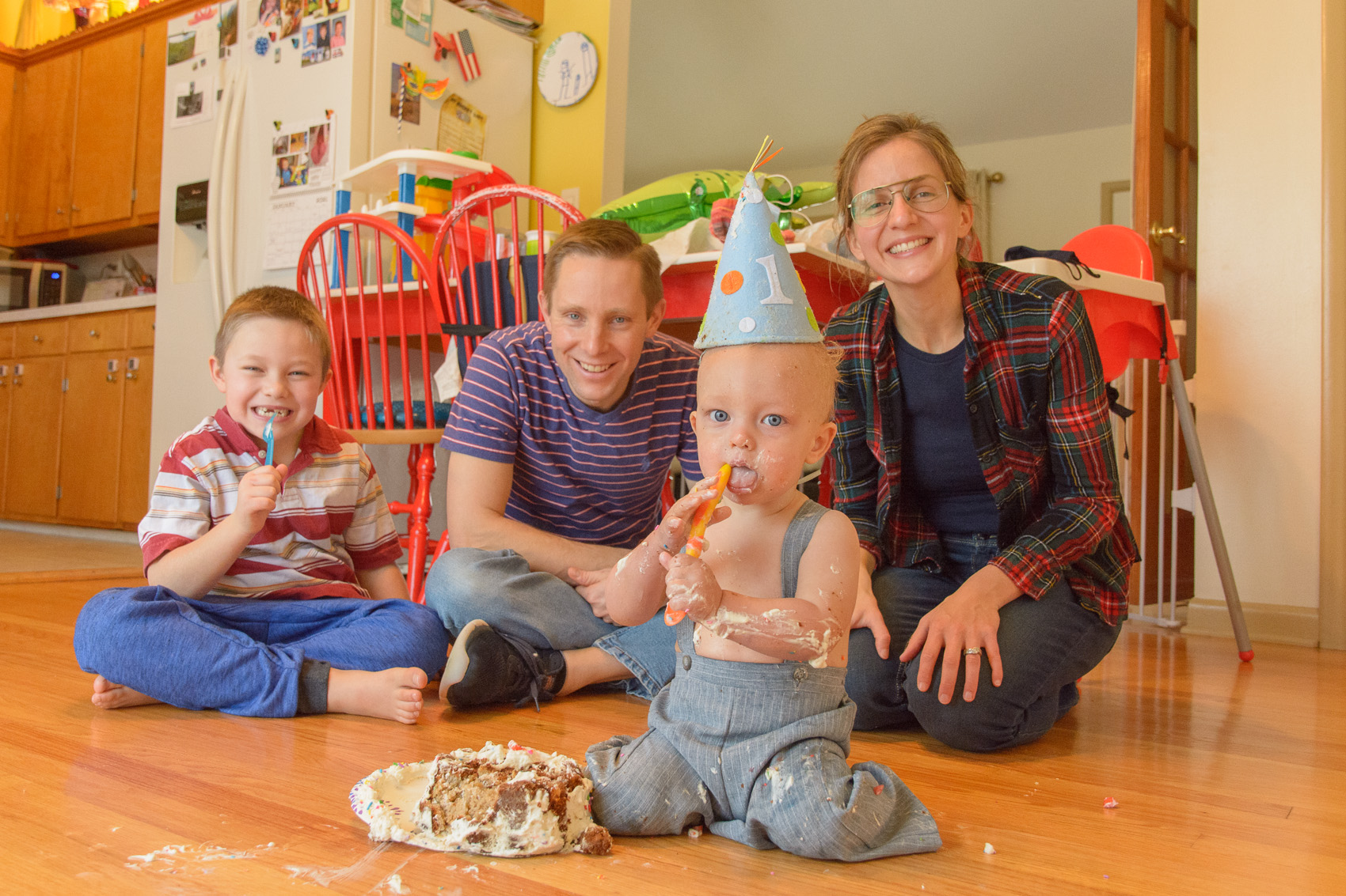infant with family at cake smash photography session