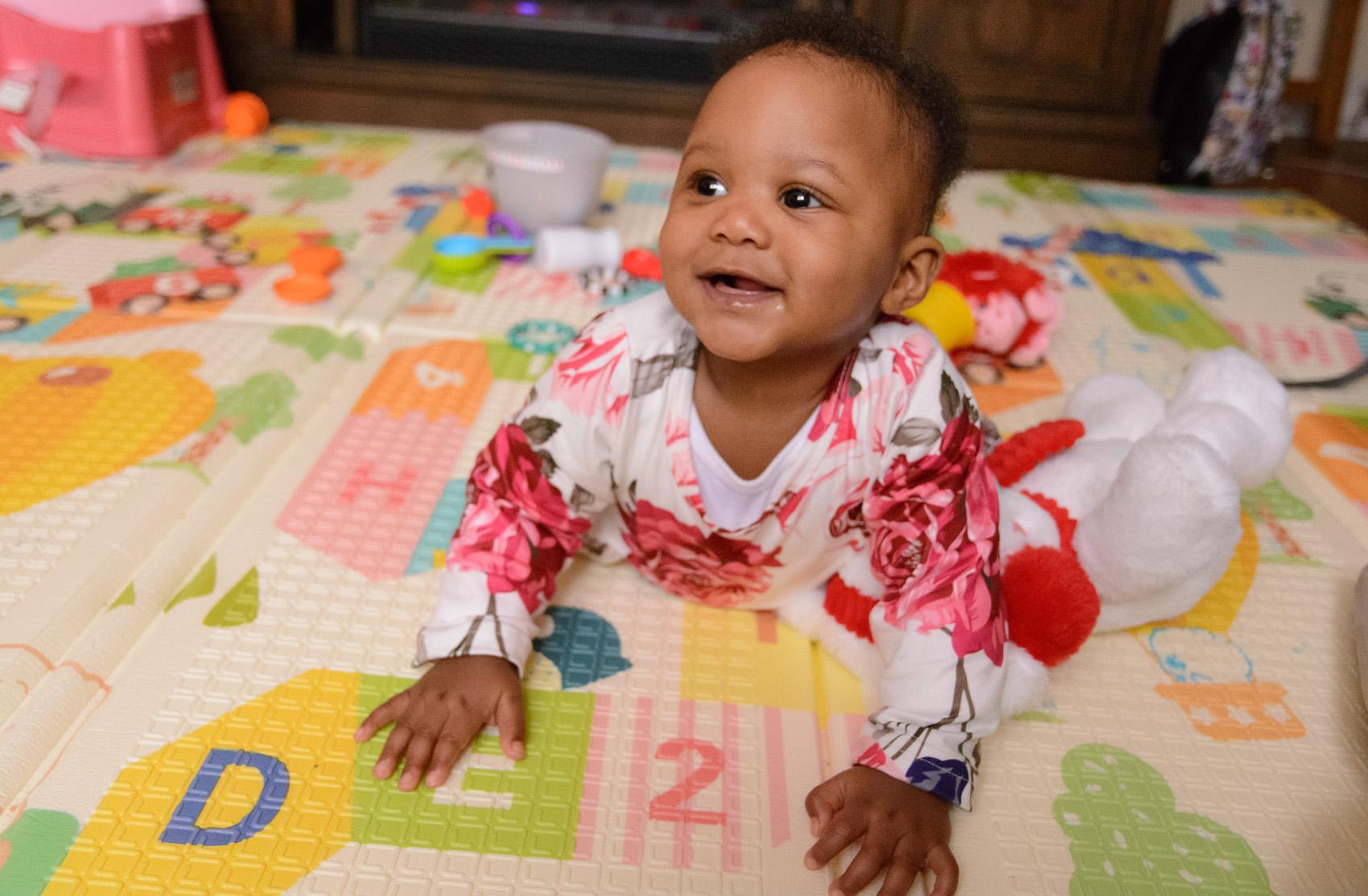 infant smiling up toward camera